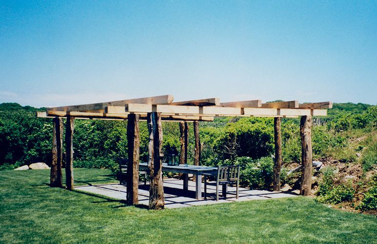 Pergola with natural cedar posts, architect's  Montauk oceanfront cottage compound
