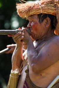 Chief with blow gun, Amazon river