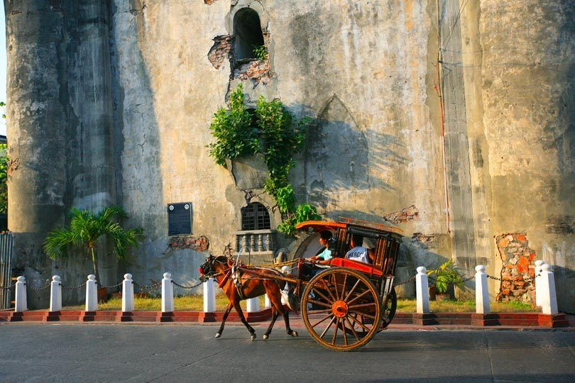 Kalesa and Laoag City Bell Tower
