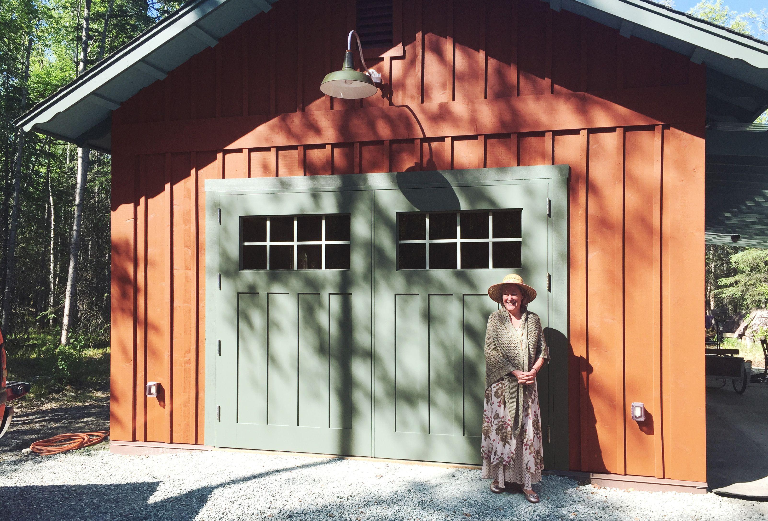 House on the meadow garage with custom built insulated barn doors