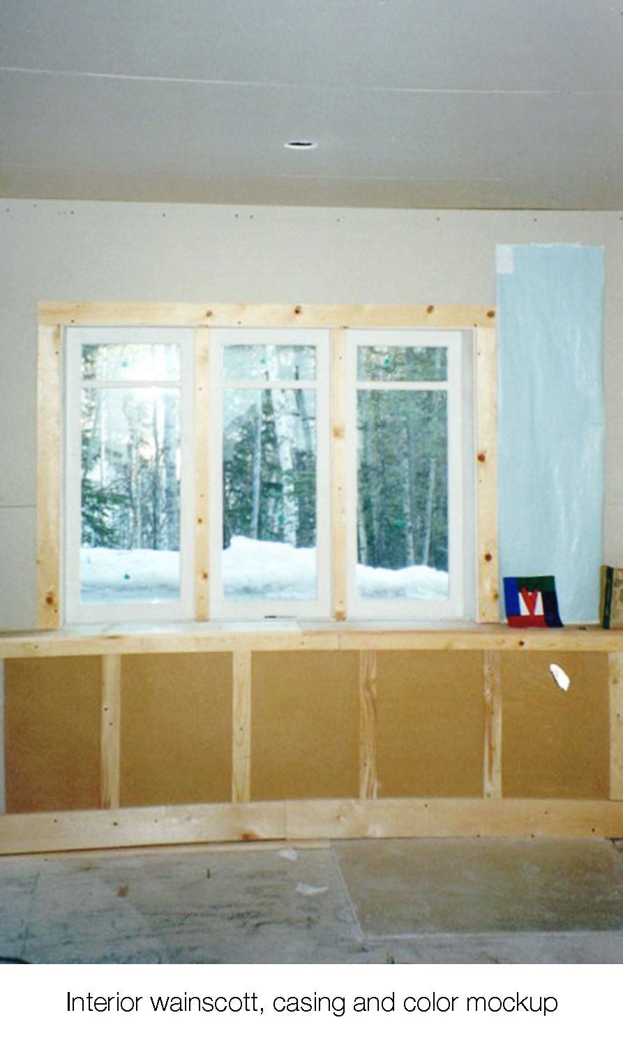House on the meadow dining room window casing, wainscotting and color mock-ups
