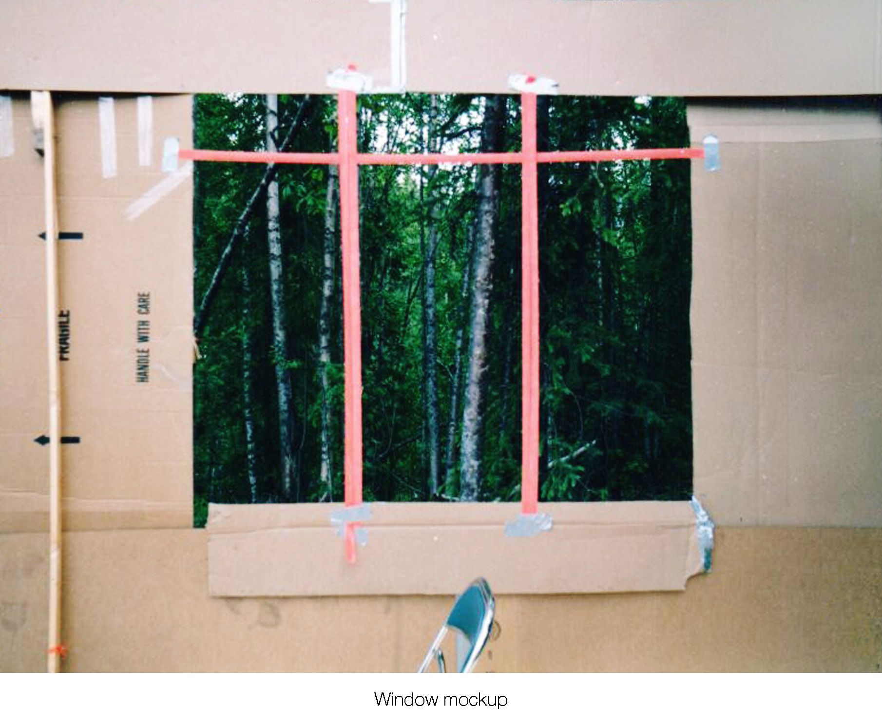 House on the meadow bedroom on site window design mock-up using surveyor tape and cardboard