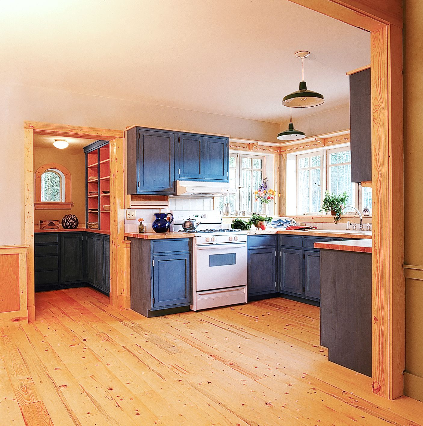 House on the meadow blue milk paint cabinetry and salvaged spruce flooring