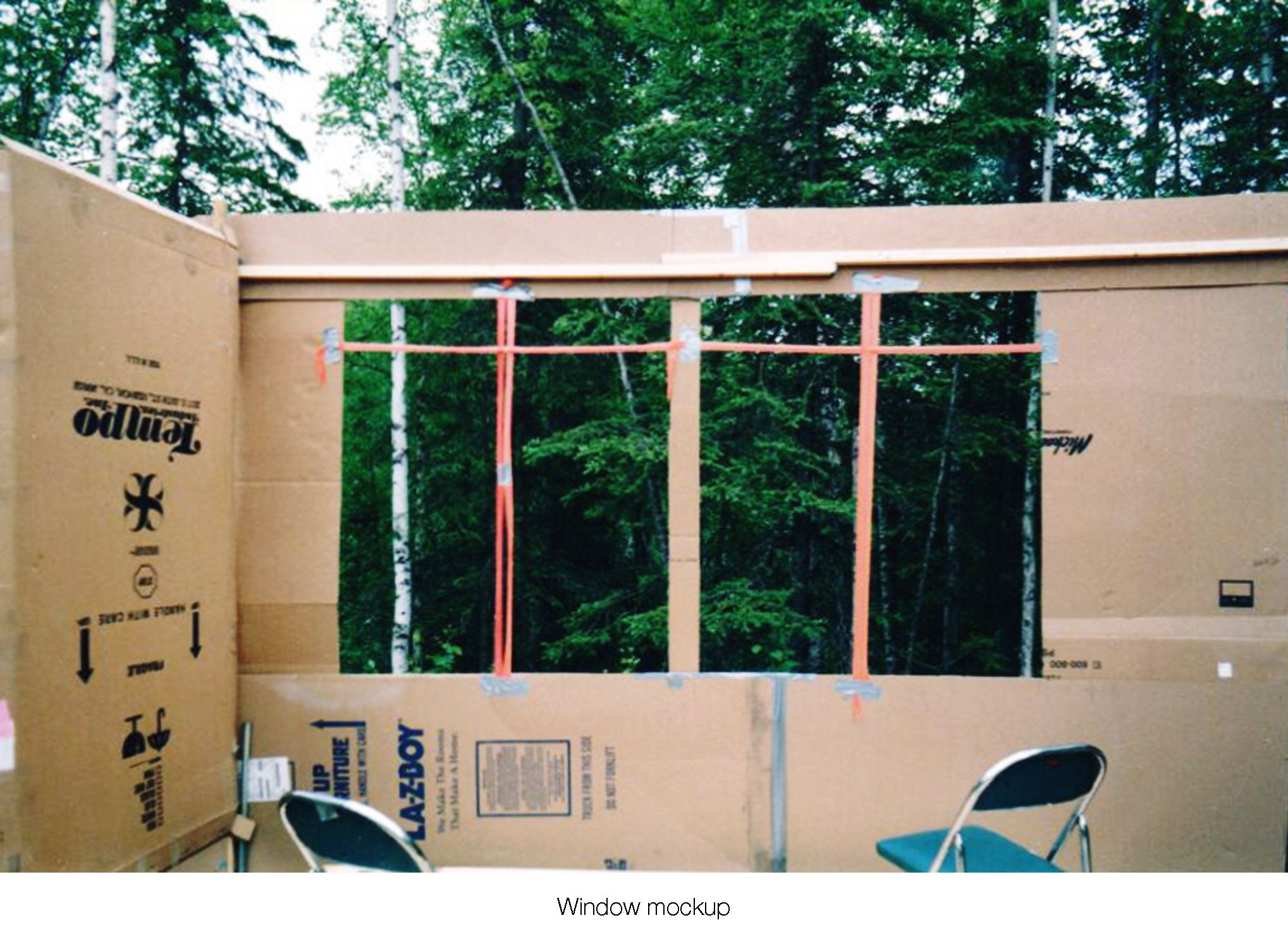 House on the meadow living room on site window design mock-up using surveyor tape and cardboard