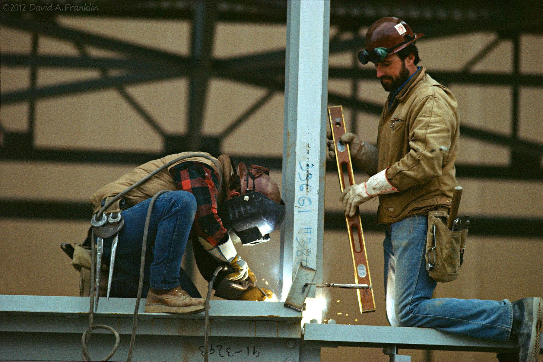IronWorkers_WeldingBeam_OfficeBuildingConstruction_Time_Editorial