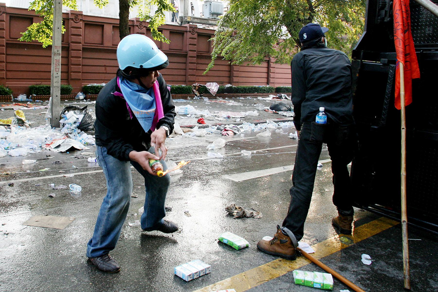 A demonstrator throws a petrol bomb at police during clashes between the People's Alliance for Democracy (PAD) and police.