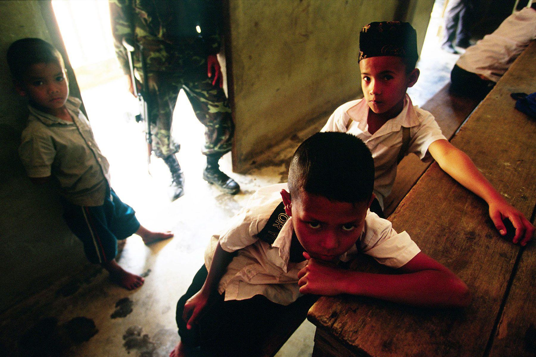 A soldier inside Muslim religious school.
