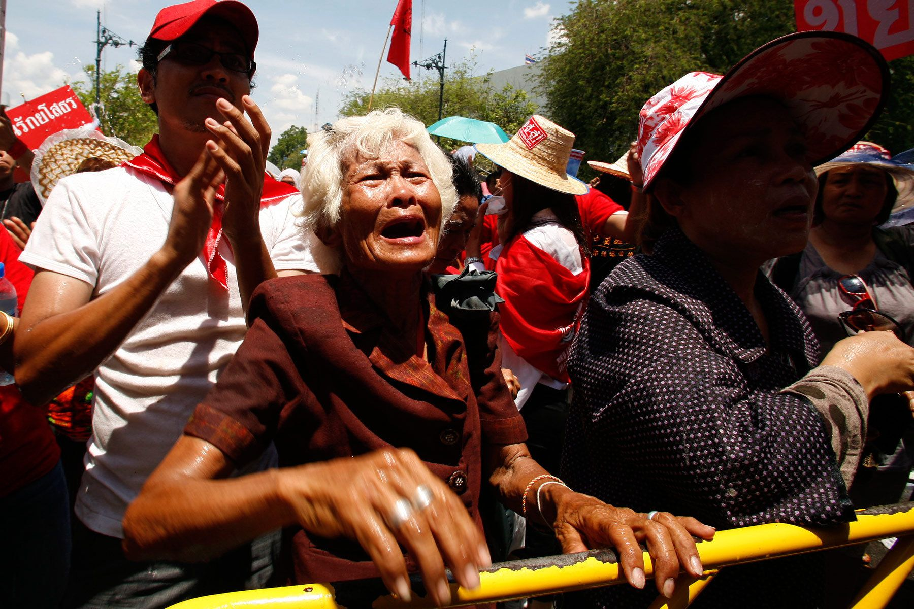 An elderly woman of the anti-government United Front for Democracy against Dictatorship (UDD) cries as she learns their leaders have called to halt their protest at Government House. Two days of rioting by the UDD left 2 people dead, 100 injurued.