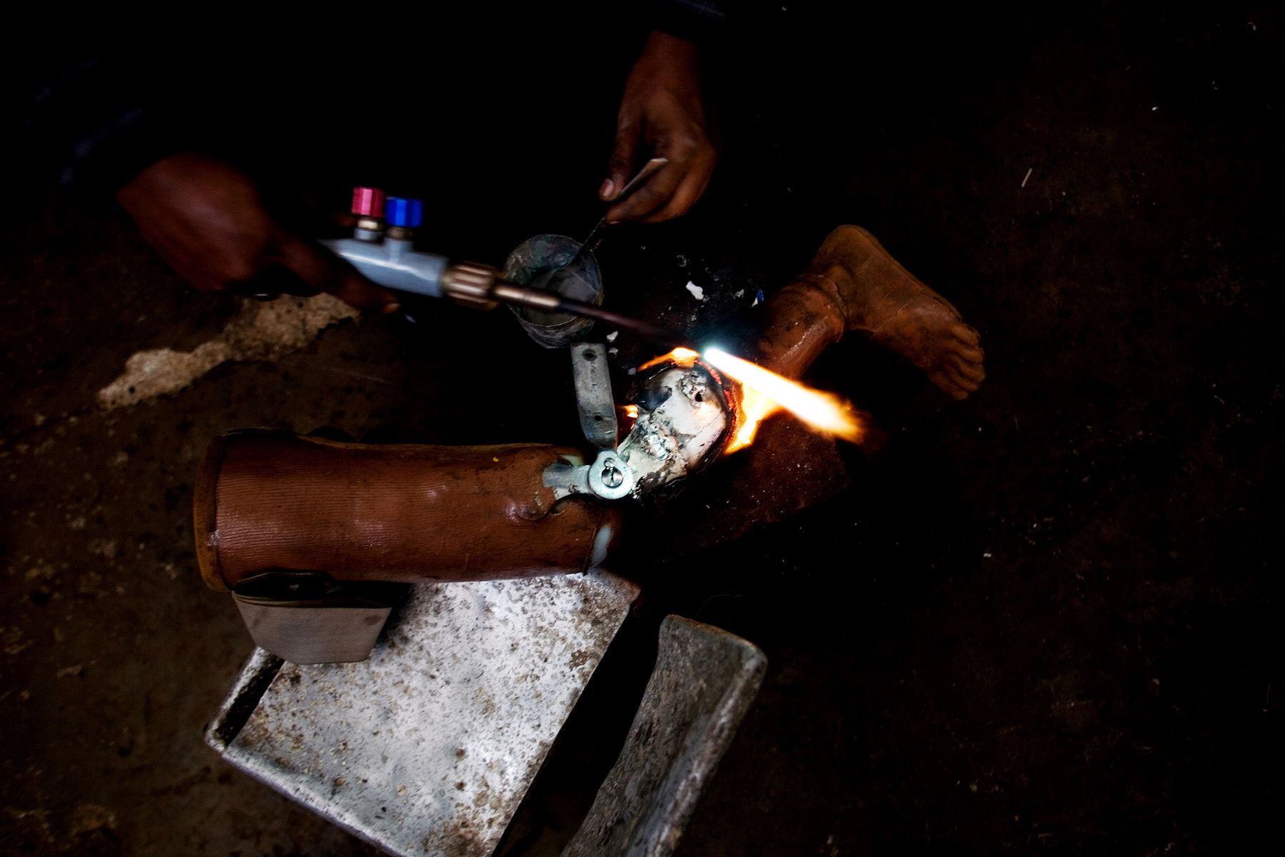A technician makes an artificial leg at a rehabilitation center for war victims.