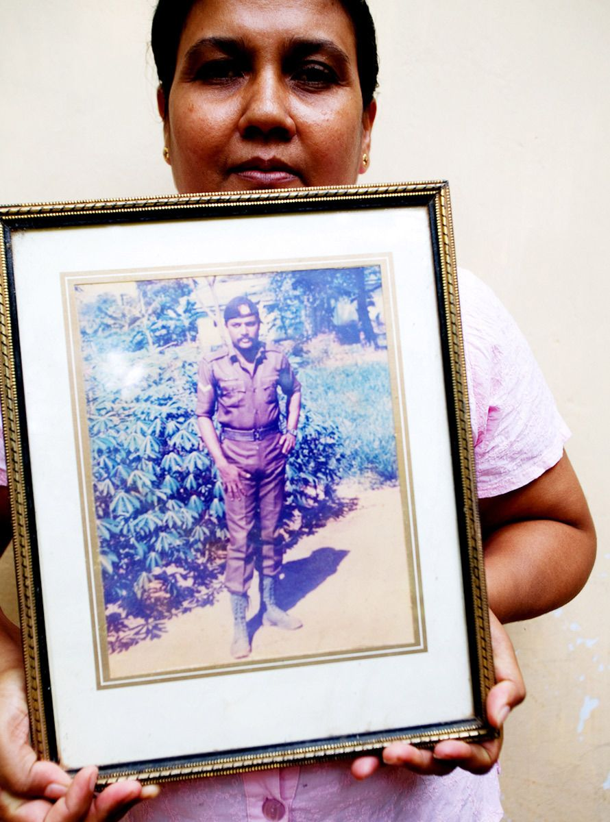 """My husband was a Sri Lankan Army soldier. They told me he was dead. I didn't see his body because he was buried in a mass grave in the North. I feel sad."""