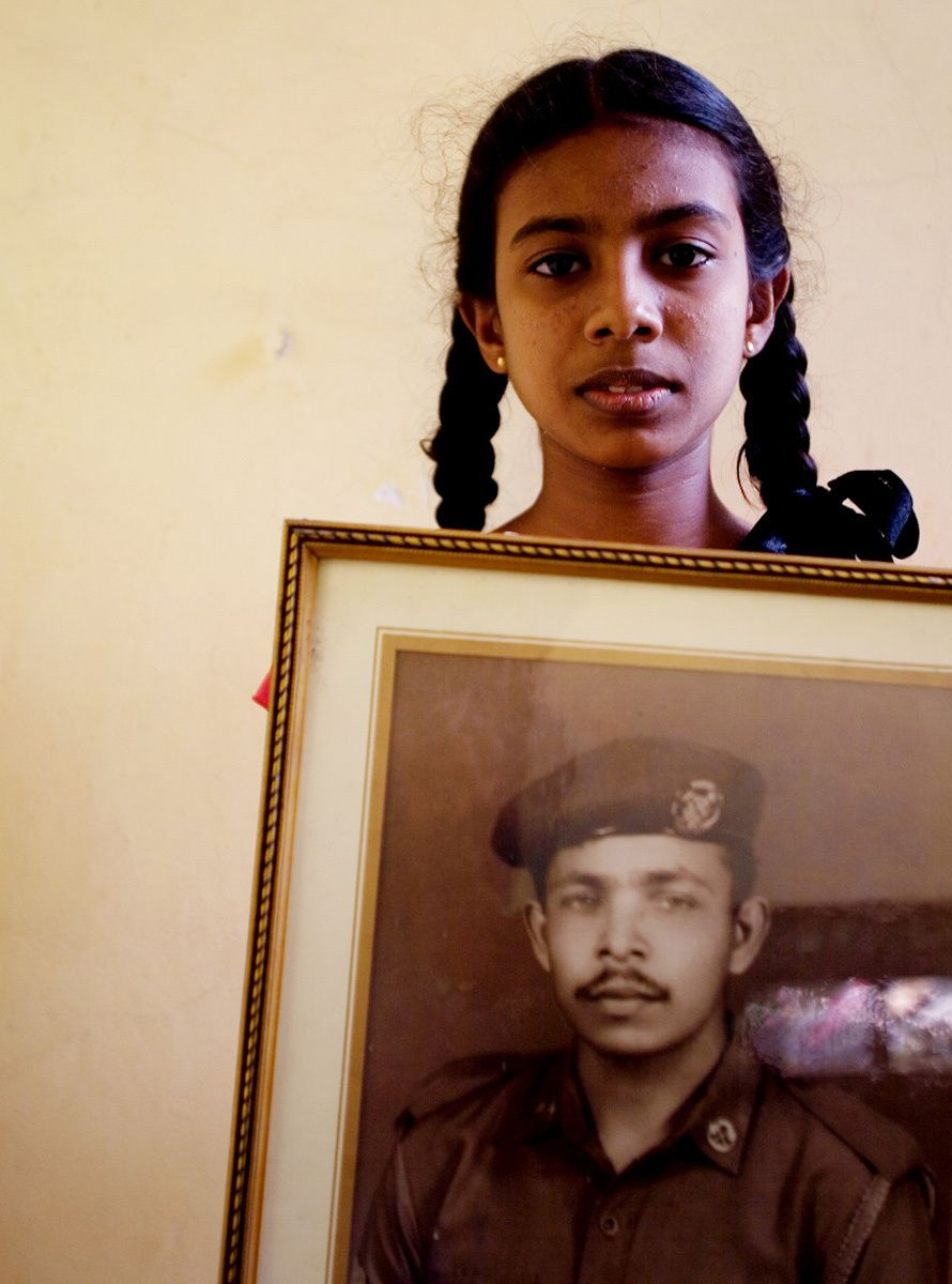 """My father died as a Sri Lanka Army soldier when I was two years old. I don't remember him, but I look at his picture every day."""
