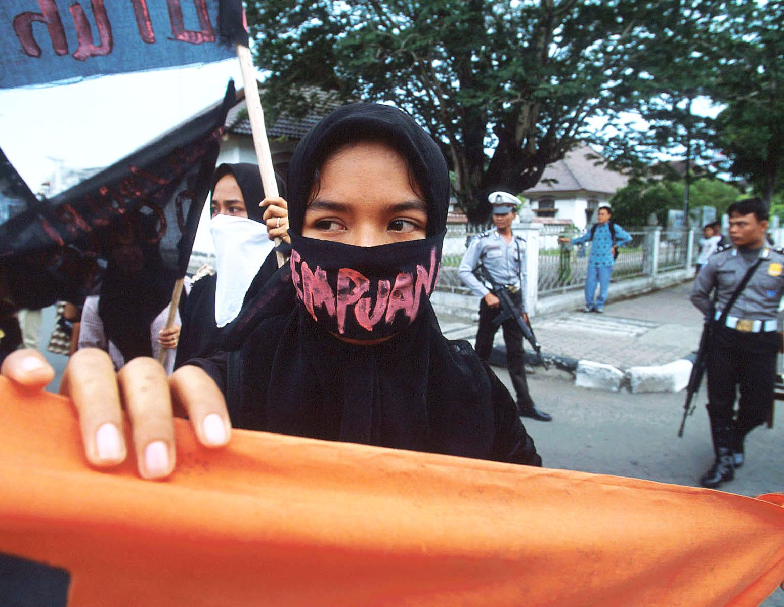 Women activists demonstrate in central Banda Aceh.They calling for more freedom and more rights.The Indonesian military broke up this peaceful demonstration. The women were beaten. Some escaped and some were arrested.