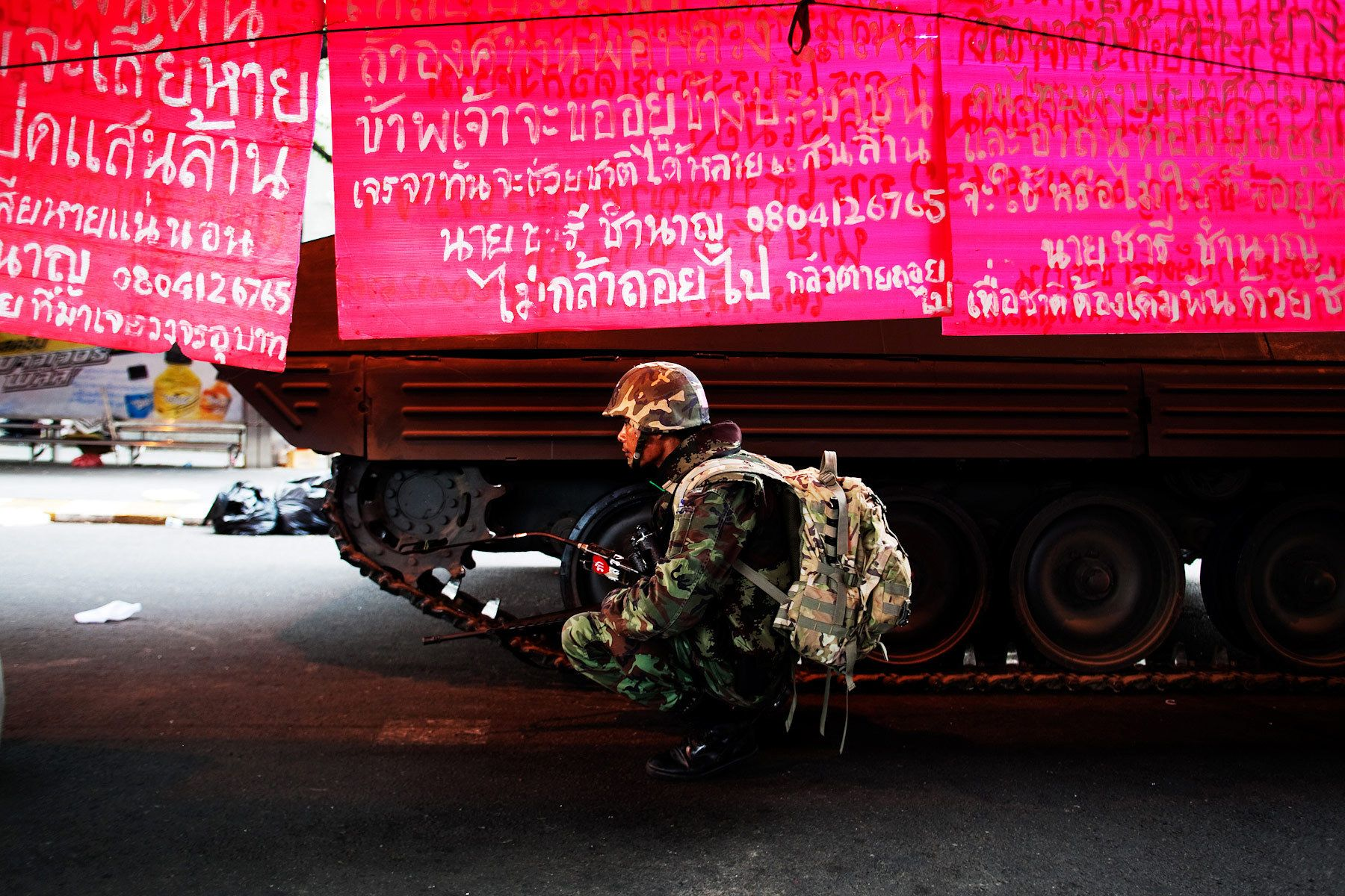 Soldiers secure the United Front for Democracy Against Dictatorship(UDD) encampment on the second day of the government crackdown against UDD demonstrators.