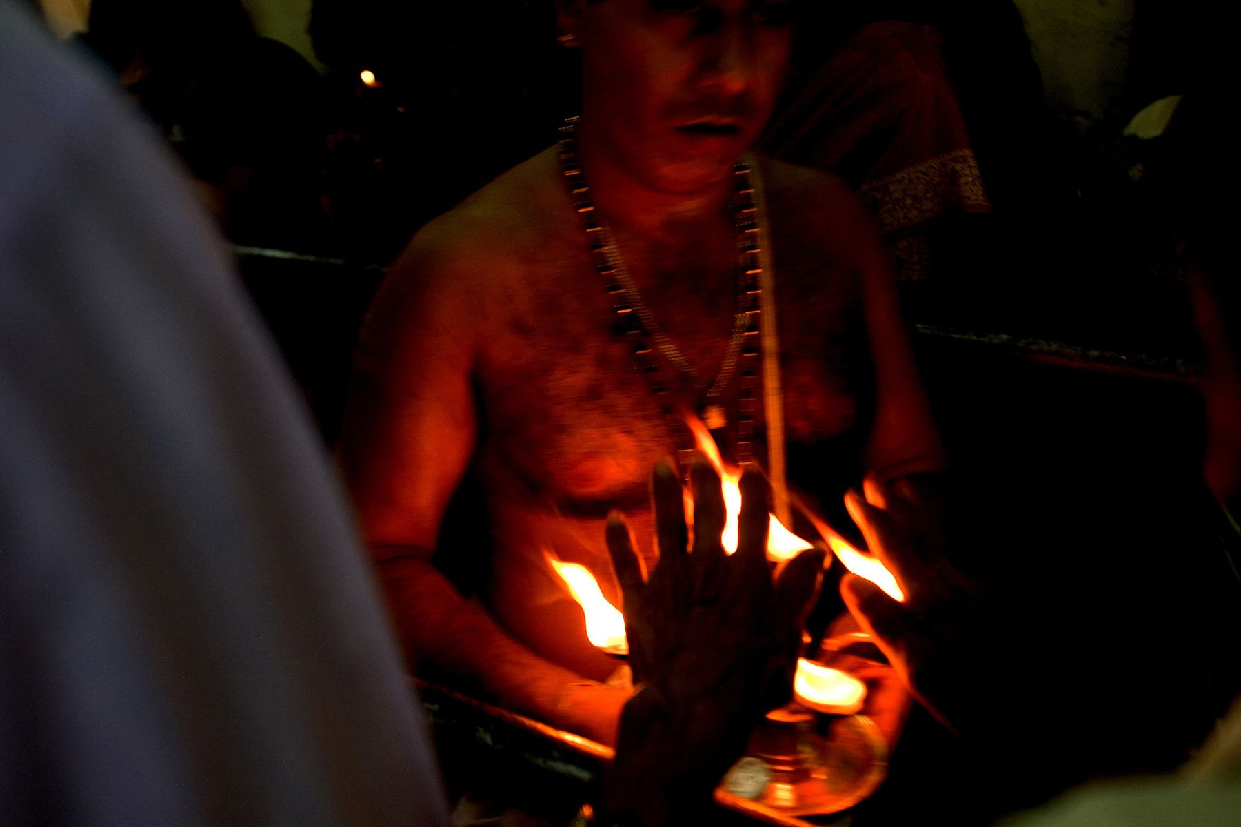 Tamil people pray at a Hindu Temple.