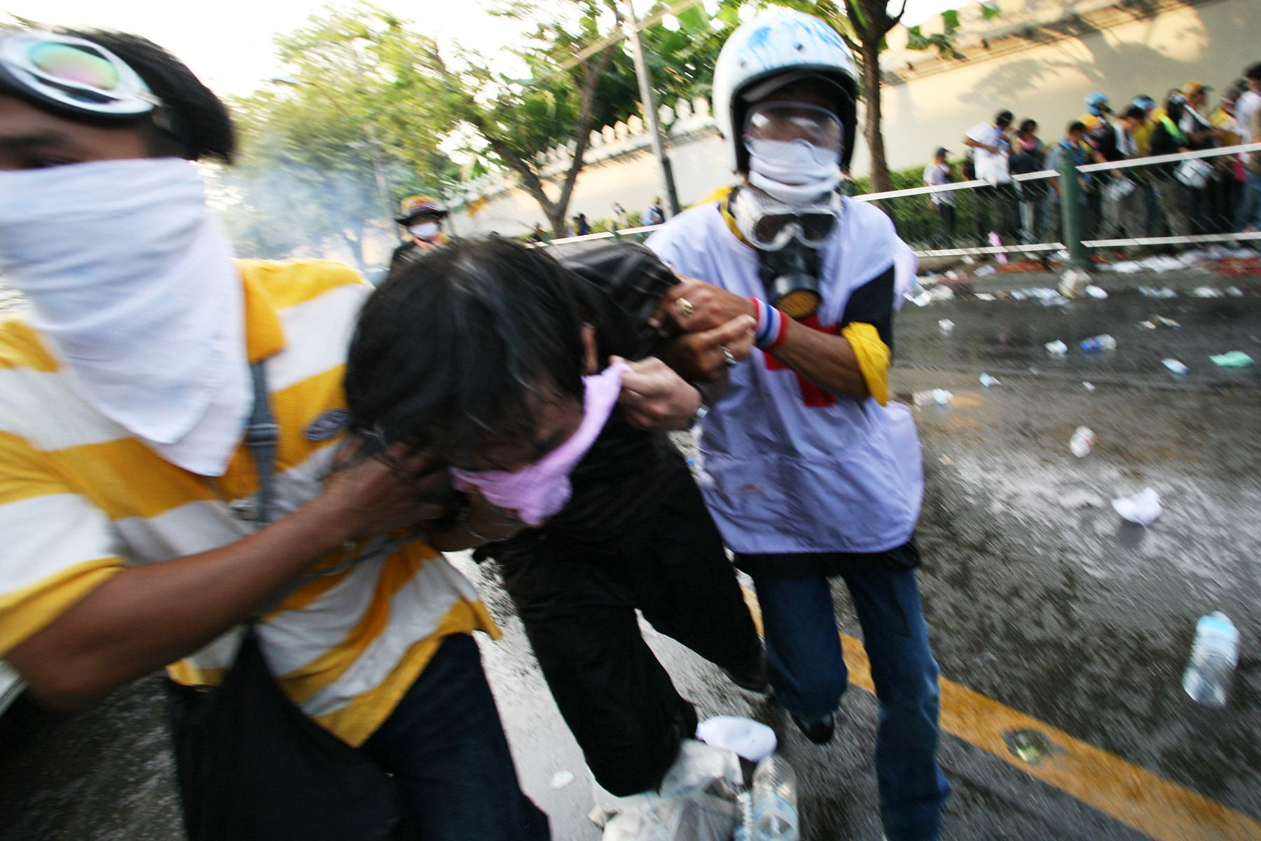 Red cross workers carry an injured demonstrator. Clashes between the opposition group People's Alliance for Democracy (PAD) who tried to block access to parliament left two people dead and some 400 injured.October 2008