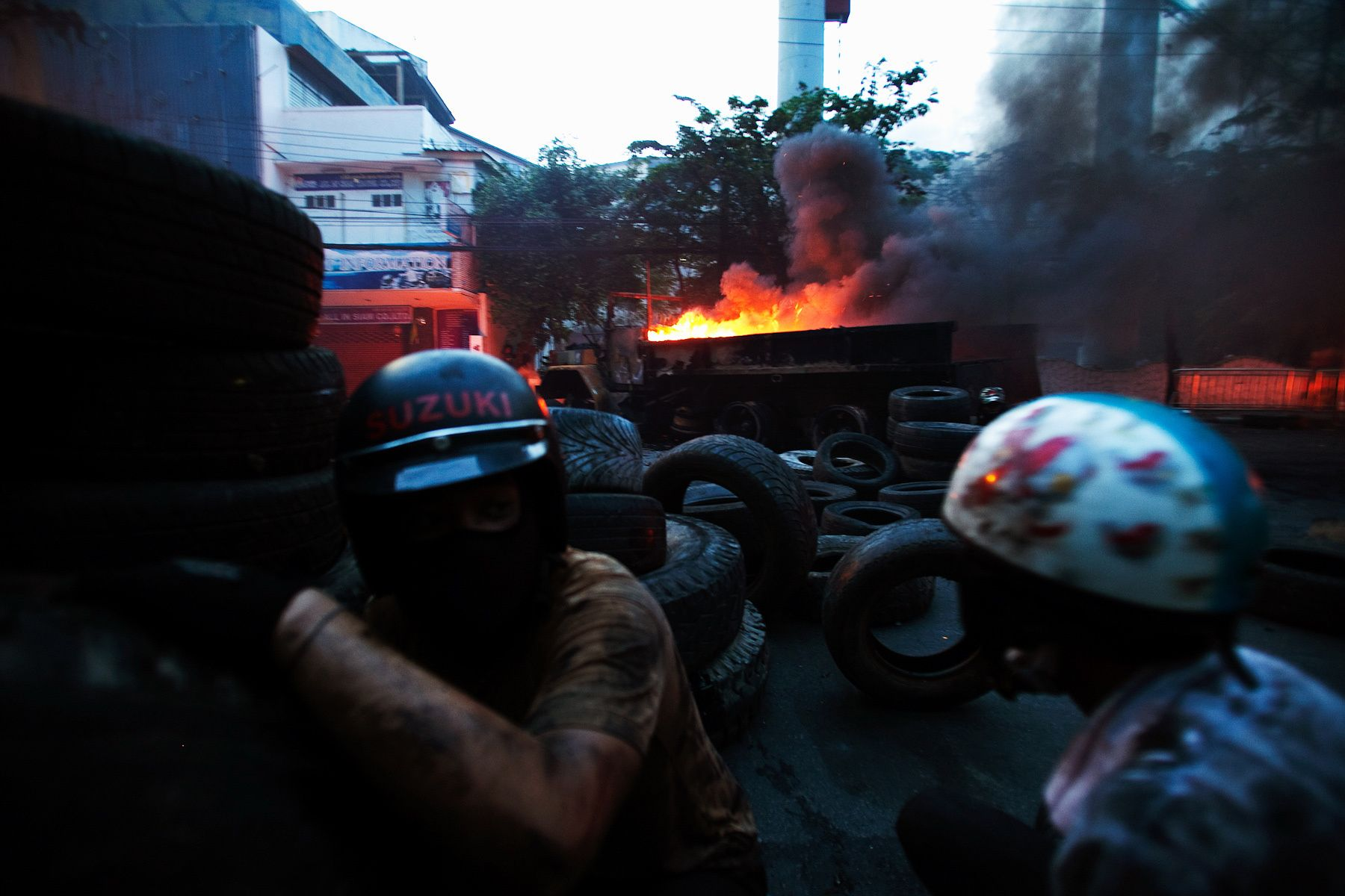Members of The United Front for Democracy Against Dictatorship(UDD) burn tires during clash with soldiers.