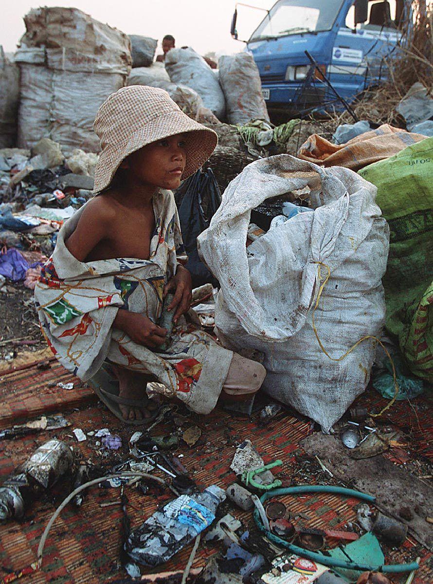 A boy works at Garbage dump.
