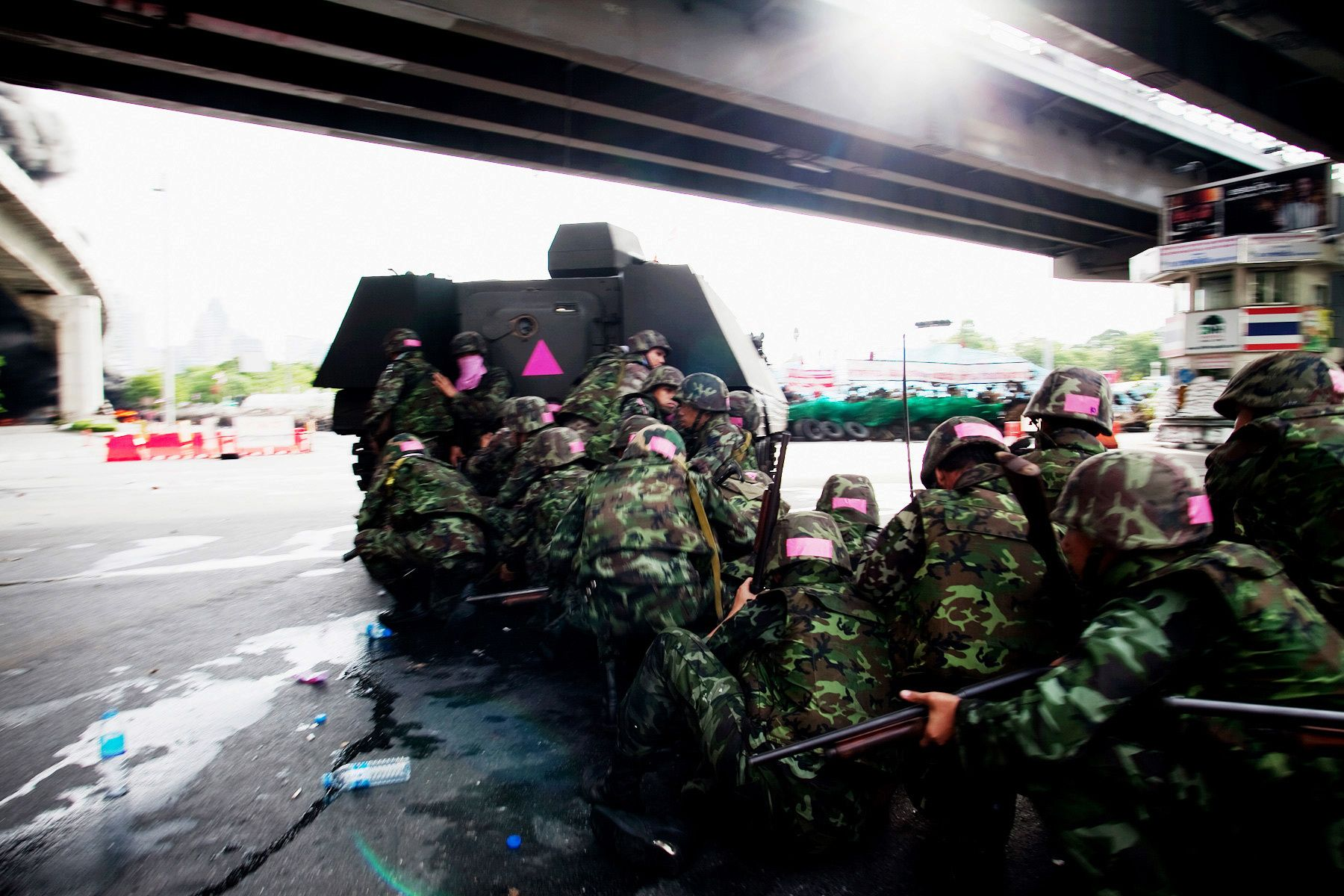 Soldiers enter the United Front for Democracy Against Dictatorship(UDD) encampment on the morning of the government crackdown against UDD demonstrators.