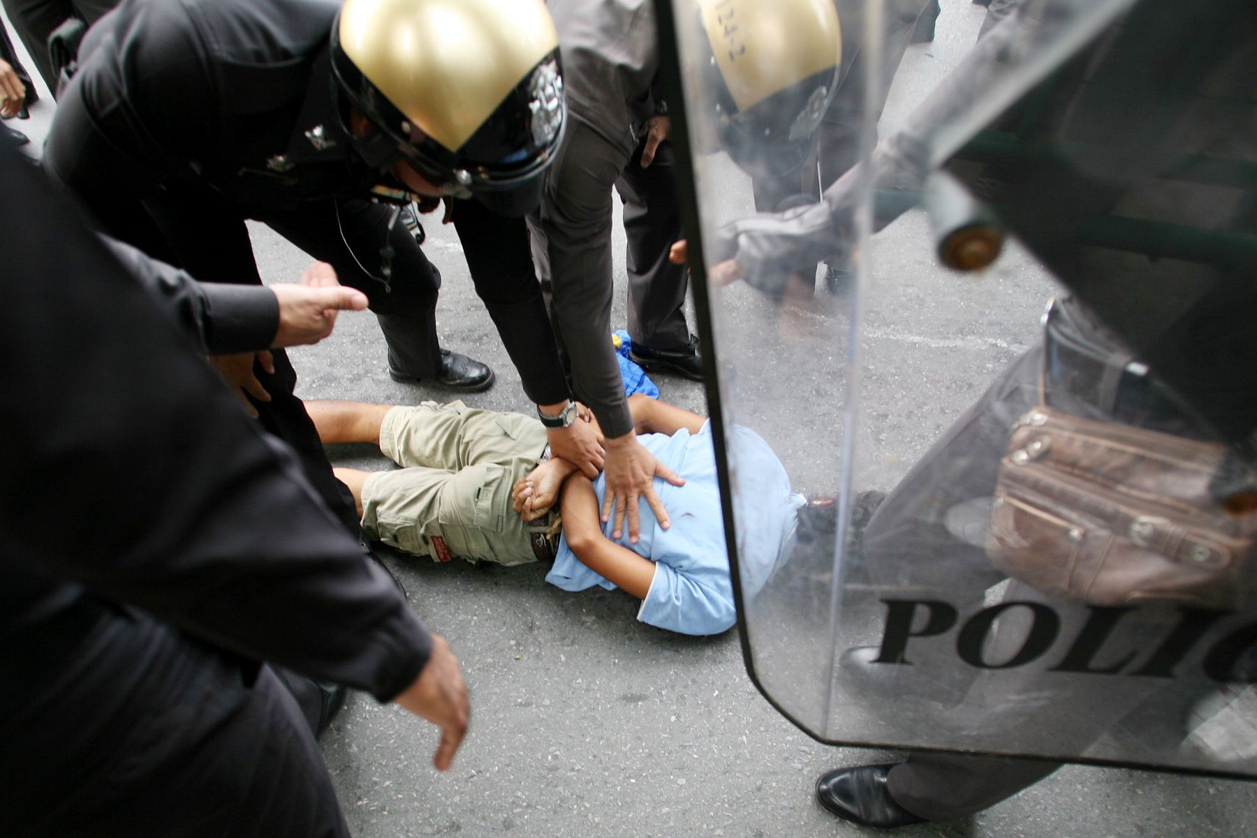 Police arrest a protester who attacked them. Clashes between police and the opposition group People's Alliance for Democracy (PAD) who tried to block access to parliament left two people dead and some 400 injured.October 2008