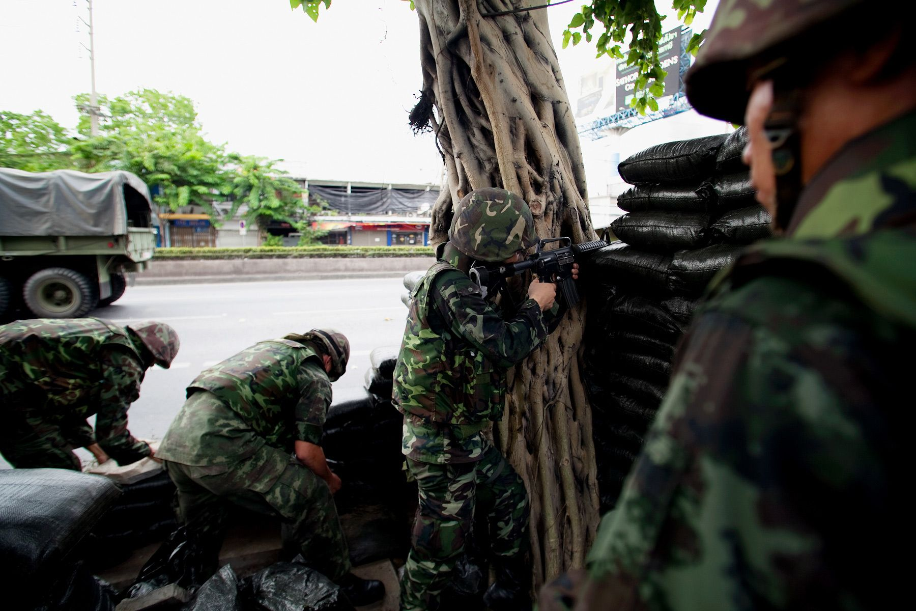 Soldiers build fortifications from sandbags near The United Front for Democracy Against Dictatorship (UDD) demonstration site.