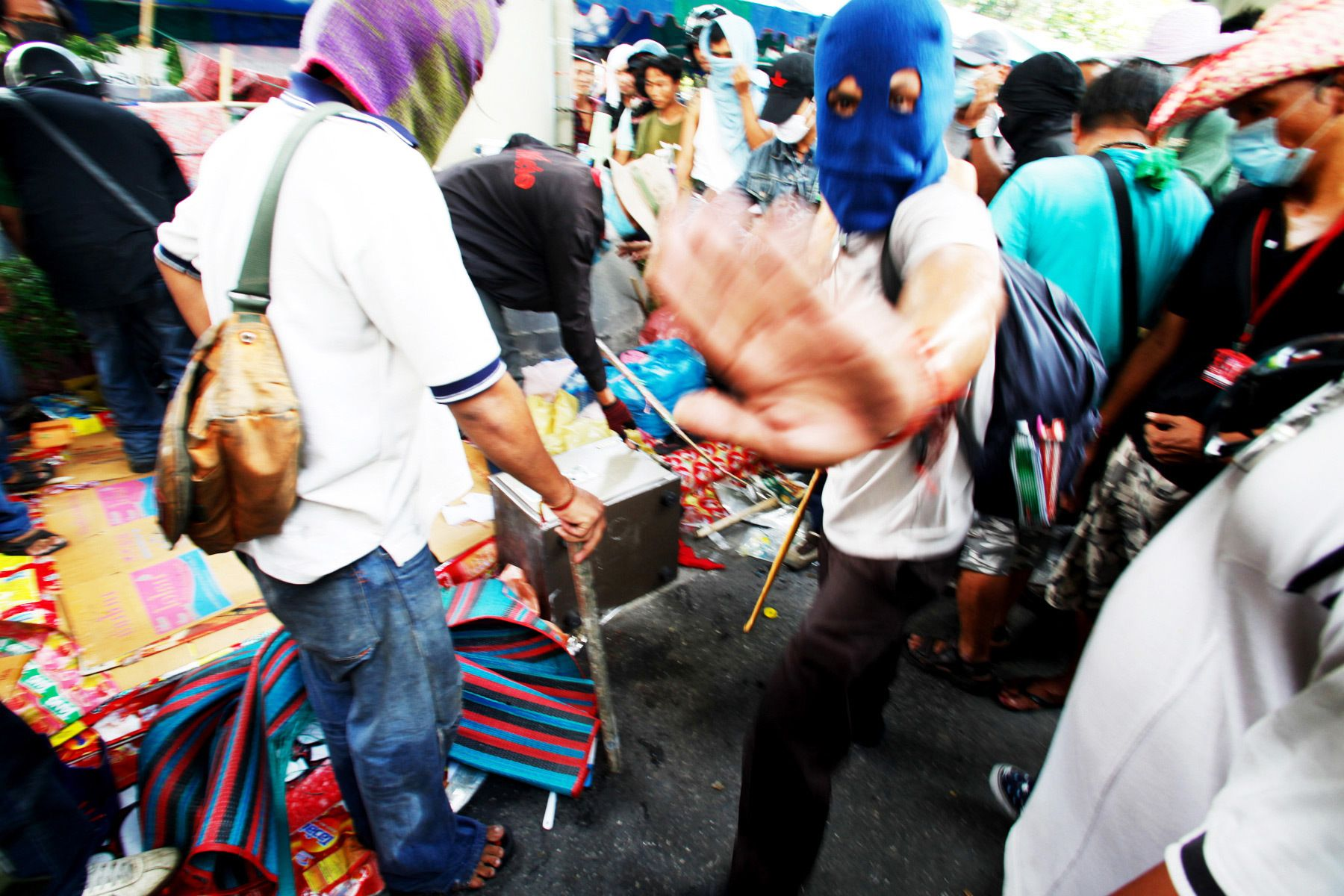 United Front for Democracy Against Dictatorship (UDD)demonstrators try to open a safe stolen from a department store during riots that followed the surrender of UDD leaders to the government.