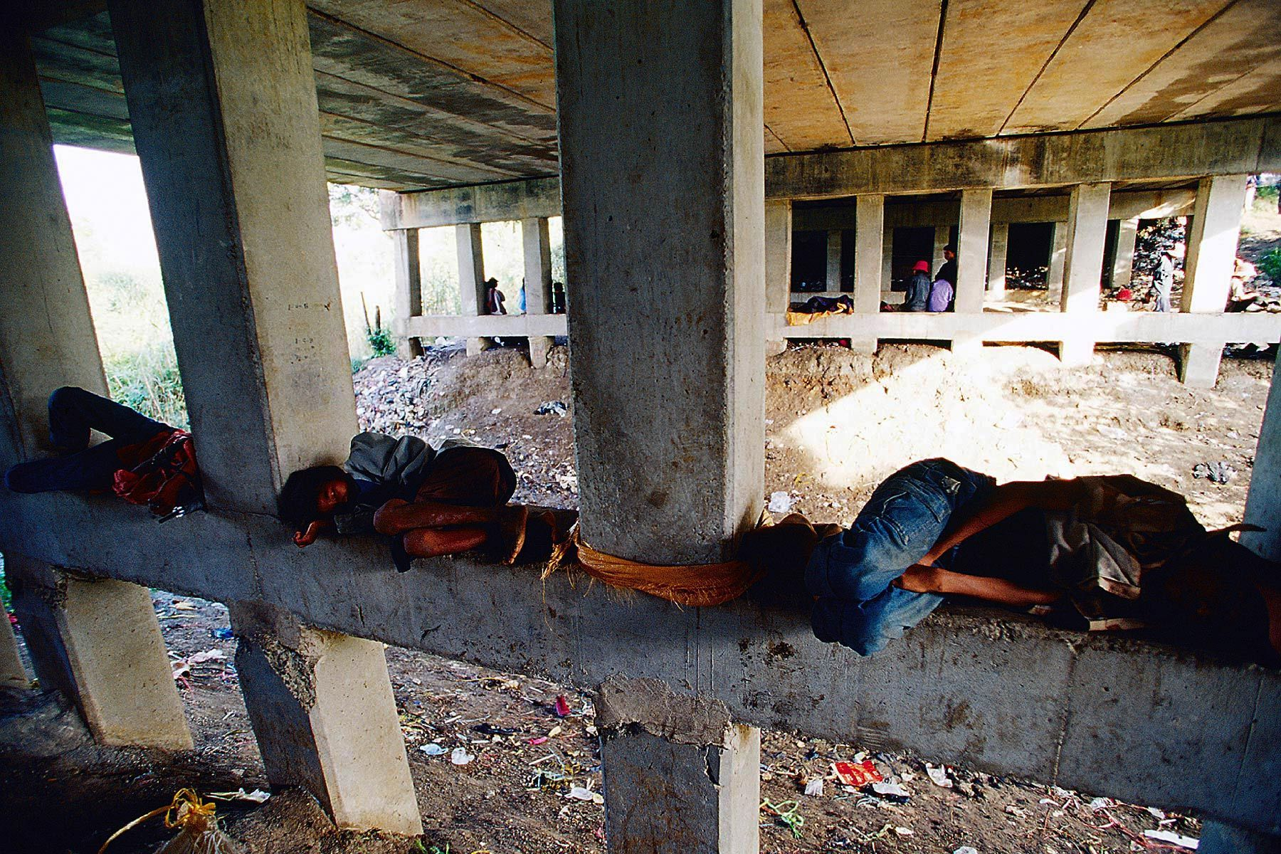 Children sleep under the bridge at border between Cambodia and Thailand.They work as smuggler and most of them are victim of child trafficking.