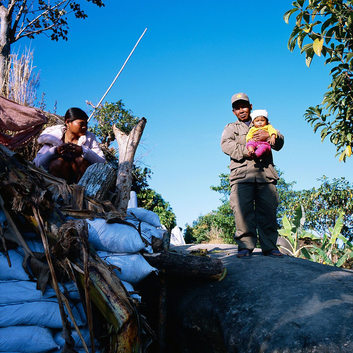 Lek, age 39, with his family in the front line.