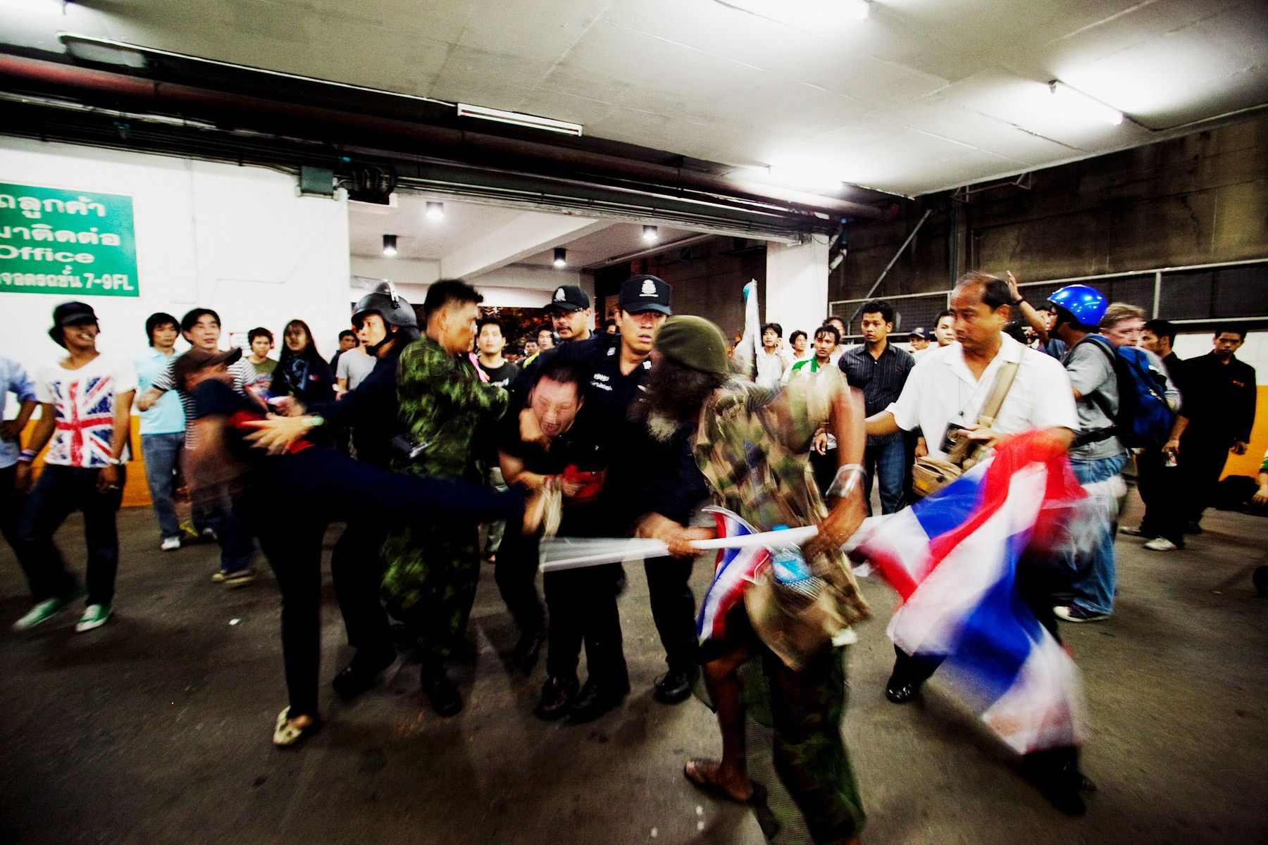 United Front for Democracy Against Dictatorship (UDD)members arrested a suspected spy then beat up inside a car parking.