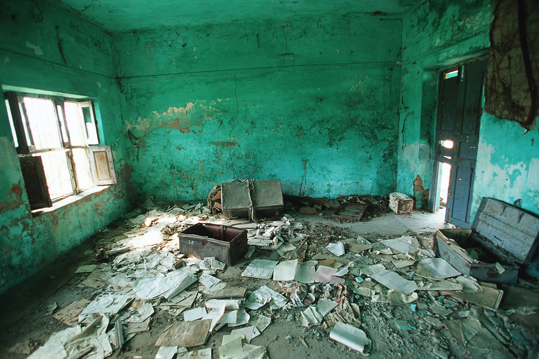 A house was destroyed during fighting with Indian Army and the Militant