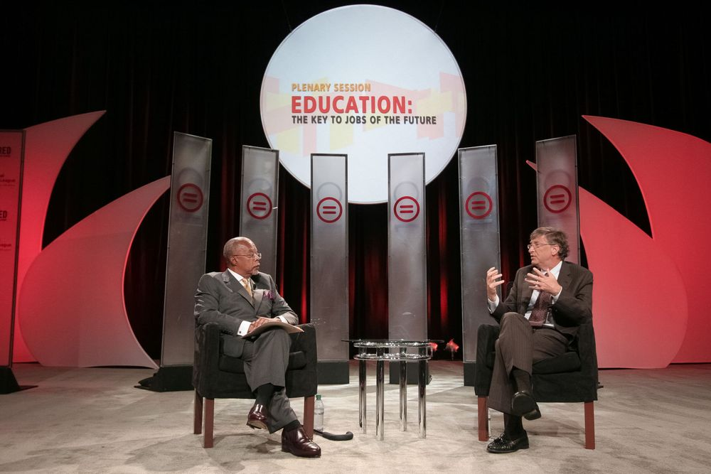 Harvard University Professor/Author Henry Louis Gates, Jr. (L) and Microsoft co-founder/Philanthropist Bill Gates speak on stage during the National Urban League's annual conference on July 28, 2011 in Boston, MA.