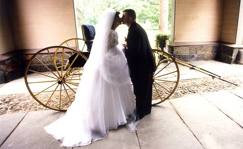 Wedding Photography Albuquerque NM - A beautiful wedding ccuple in a rustic setting complete with a horseless carriage!