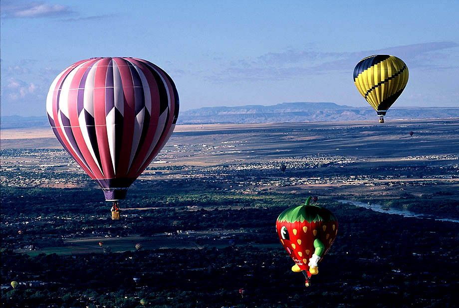 Albuquerque International Balloon Fiesta Photography - Balloons In Flight - A Spectacular View of The City Below and the Surrounding Mountains in The Distance
