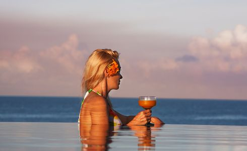 1Woman_in_pool_at_sunset_with_a_tropical_drink.jpg