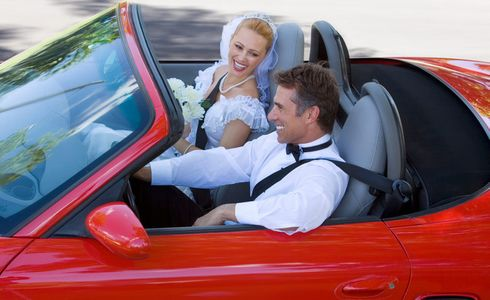 1Newlyweds_driving_in_a_red_convertible.jpg