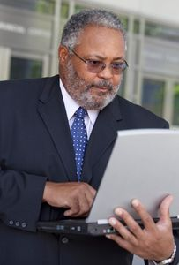 1Businessman_looks_intently_at_his_laptop_1.jpg