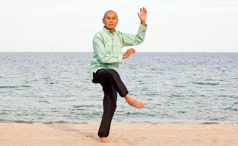 1Senior_Asian_man_practicing_Tai_Chi_on_beach.jpg