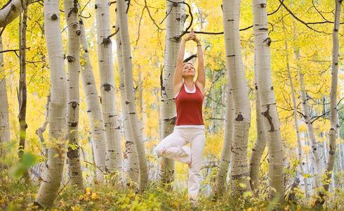 1Woman_doing_yoga_amongst_Fall_Aspen_trees.jpg