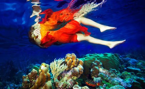 1Underwater_view_of_a_woman_floating_in_the_sea_above_reef_2.jpg