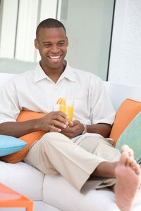 1Smiling_casual_man_relaxing_with_a_drink.jpg