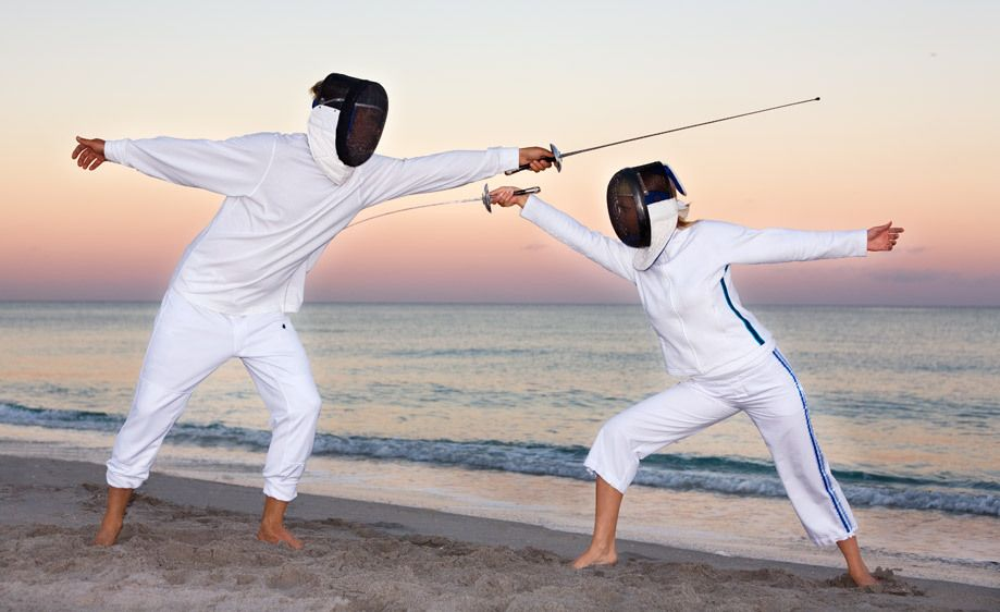 1Male_and_female_fencer_dueling_on_the_beach.jpg