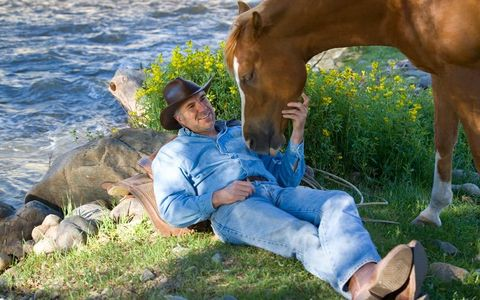 1Cowboy_relaxing_outdoors_with_his_horse.jpg