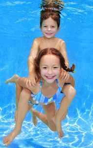 1Sis_gives_brother_piggy_back_ride_underwater.jpg