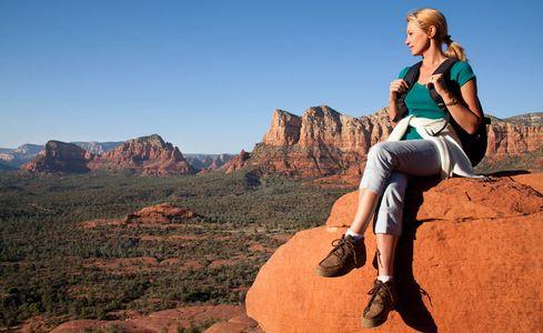 1Woman_hiker_relaxes_on_a_mesa_peak.jpg