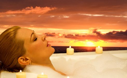 1Woman_relaxes_in_a_spa_resort_at_sunset.jpg