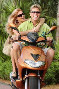 1Smiling_couple_on_motor_sco.jpg