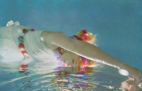 1beautiful_woman_floating_dreamlike_on_water.jpg
