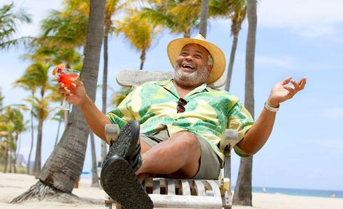 1Happy_man_relaxing_with_a_drink_at_tropical_beach.jpg