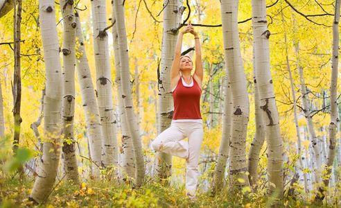 1Woman_doing_yoga_amongst_Fall_Aspen_trees