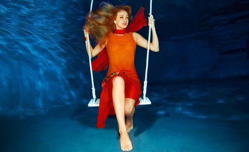 1Woman_in_red_dress_on_a_swing_underwater.jpg