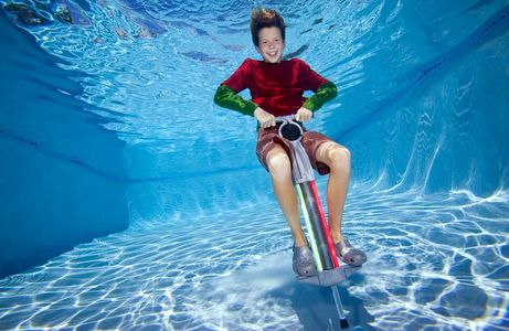 1Boy_jumping_on_Pogo_Stick_underwater.jpg